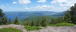 "Betsy can't say enough about opportunities for outdoor recreation in our area. She says, ""The Adirondack Mountains are the reason I moved here and the reason I continue to love living here. If you're a hiker, biker, climber, or skier, this is a heavenly place to be! I recommend working on one of our local hiking challenges, like the Saranac Lake 6er, Adirondack Fire Tower Challenge, or if you're more advanced, becoming a 46er. You'll discover places you never knew existed and have some incredible adventures along the way!"""